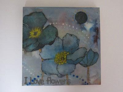 Schilderij gemaakt met gekleurde schilderwas in blik en servetten.