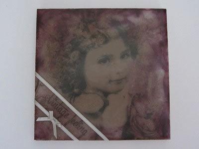 Schilderij gemaakt met transparant (wit) schilderwas in blik en servetten.